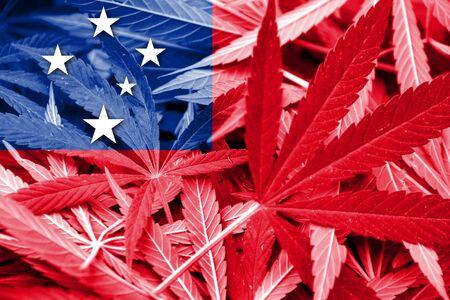 marihuana: Samoa Flag on cannabis background. Drug policy. Legalization of marijuana