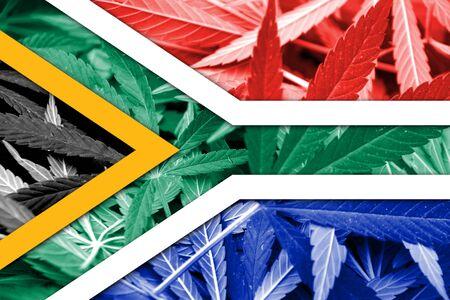 drug dealer: South Africa Flag on cannabis background. Drug policy. Legalization of marijuana Stock Photo