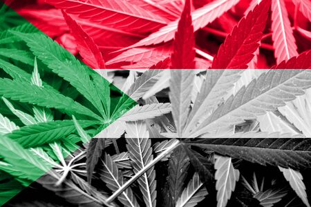 smuggling: Sudan Flag on cannabis background. Drug policy. Legalization of marijuana