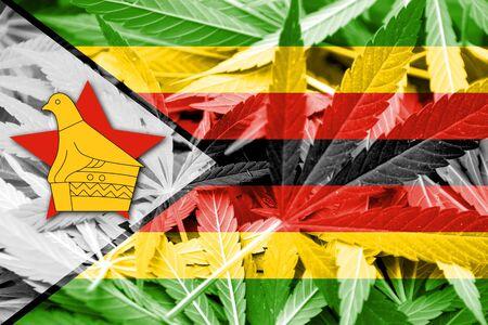 thc: Zimbabwe Flag on cannabis background. Drug policy. Legalization of marijuana