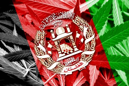 middle joint: Afghanistan Flag on cannabis background. Drug policy. Legalization of marijuana Stock Photo