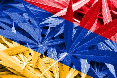 marihuana: Armenia Flag on cannabis background. Drug policy. Legalization of marijuana