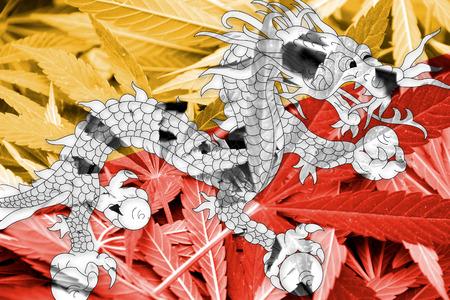 marihuana: Bhutan Flag on cannabis background. Drug policy. Legalization of marijuana