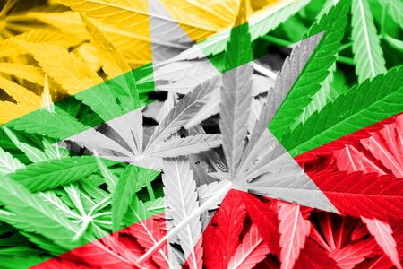 smuggling: Burma Flag on cannabis background. Drug policy. Legalization of marijuana Stock Photo