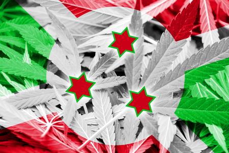 drug dealer: Burundi Flag on cannabis background. Drug policy. Legalization of marijuana