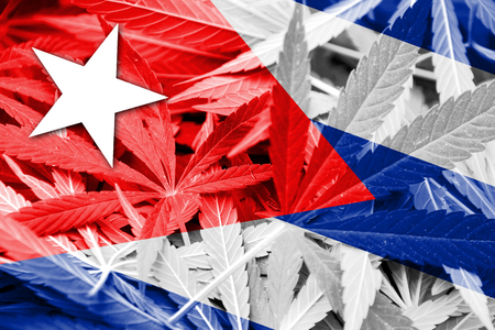 smuggling: Cuba Flag on cannabis background. Drug policy. Legalization of marijuana Stock Photo