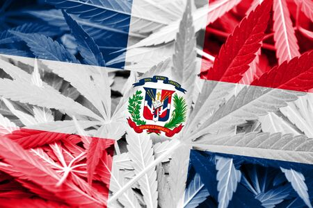 legalization: Dominican Republic Flag on cannabis background. Drug policy. Legalization of marijuana
