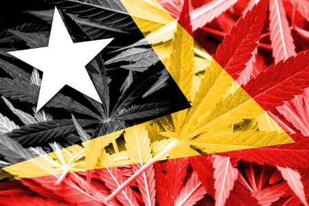 drug dealer: East Timor Flag on cannabis background. Drug policy. Legalization of marijuana