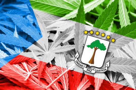 legalization: Equatorial Guinea Flag on cannabis background. Drug policy. Legalization of marijuana