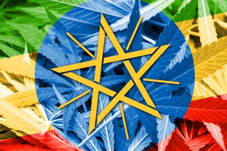 marihuana: Ethiopia Flag on cannabis background. Drug policy. Legalization of marijuana
