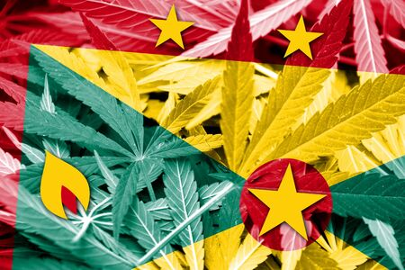 smuggling: Grenada Flag on cannabis background. Drug policy. Legalization of marijuana Stock Photo