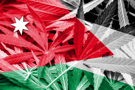 middle joint: Jordan Flag on cannabis background. Drug policy. Legalization of marijuana
