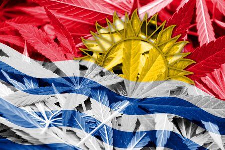 marihuana: Kiribati Flag on cannabis background. Drug policy. Legalization of marijuana Stock Photo
