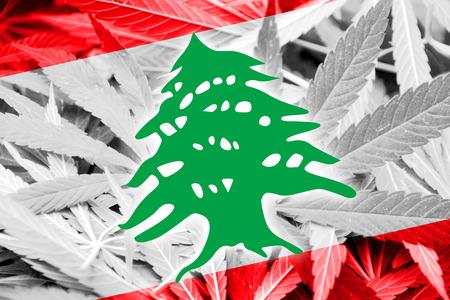 grass close up: Lebanon Flag on cannabis background. Drug policy. Legalization of marijuana