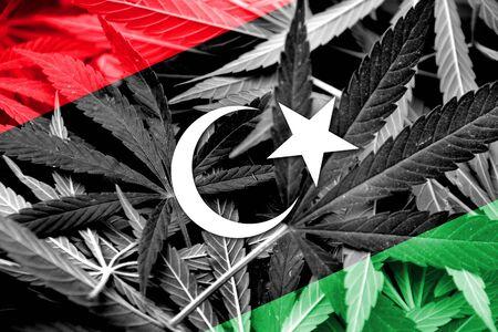 drug dealer: Libya Flag on cannabis background. Drug policy. Legalization of marijuana