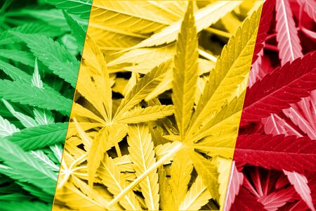 smuggling: Mali Flag on cannabis background. Drug policy. Legalization of marijuana