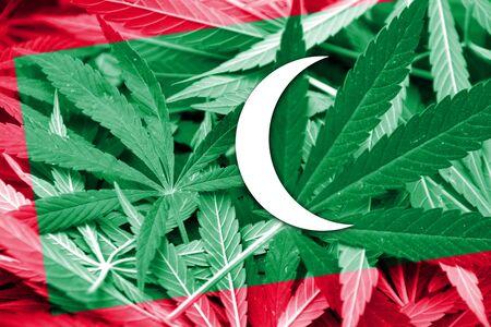 maldives island: Maldives Flag on cannabis background. Drug policy. Legalization of marijuana