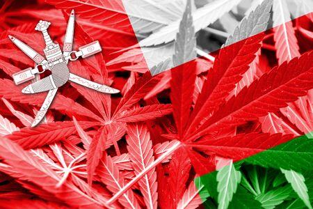 drug dealer: Oman Flag on cannabis background. Drug policy. Legalization of marijuana Stock Photo