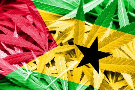 drug dealer: Sao Tome and Principe Flag on cannabis background. Drug policy. Legalization of marijuana Stock Photo