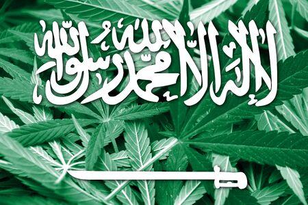 drug dealer: Saudi Arabia Flag on cannabis background. Drug policy. Legalization of marijuana