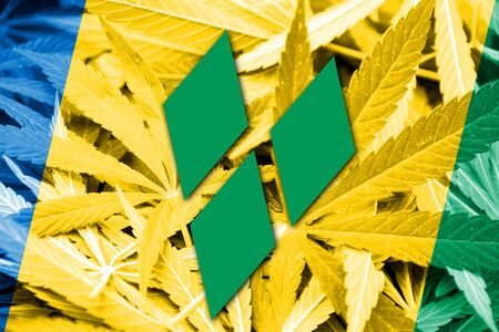 grenadines: Saint Vincent and The Grenadines Flag on cannabis background. Drug policy. Legalization of marijuana