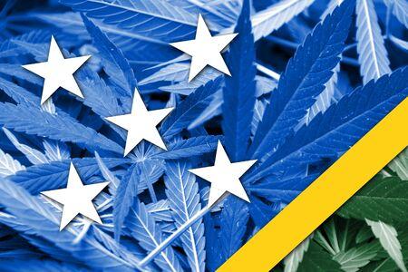 marihuana: Solomon Islands Flag on cannabis background. Drug policy. Legalization of marijuana