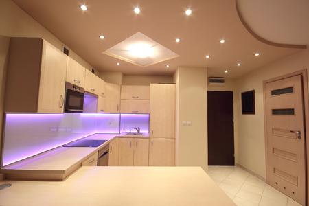 Modern luxury kitchen with pink LED lighting Standard-Bild