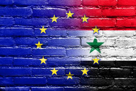 emigranti: UE e la Siria bandiera dipinta sul muro di mattoni