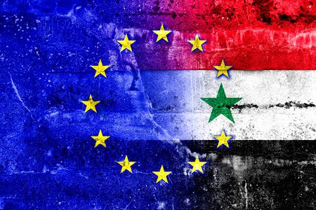 middle east crisis: EU and Syria Flag painted on grunge wall