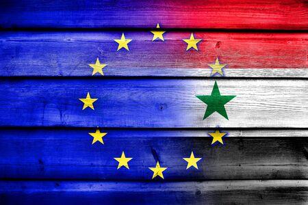 middle east crisis: EU and Syria Flag on wood background