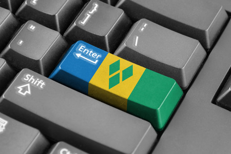 grenadines: Enter button with Saint Vincent and The Grenadines Flag Stock Photo