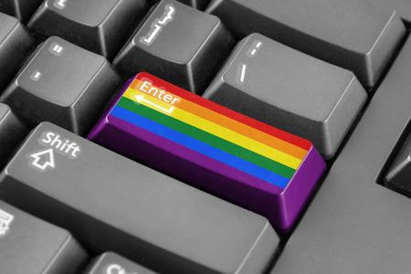 arc en ciel: Entrez bouton avec Rainbow Flag Banque d'images