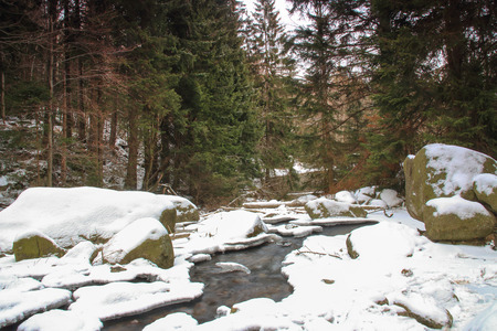 winterly: Winter river in the Polish forest. Mountain rocks covered with snow