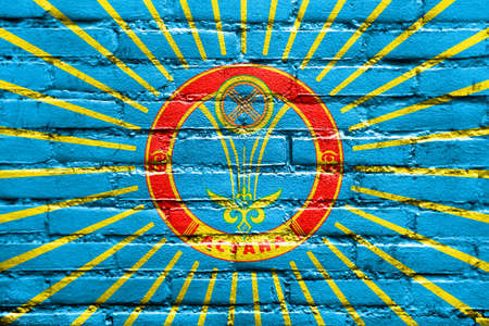education policy: Flag of Astana, painted on brick wall