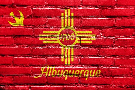 albuquerque: Flag of Albuquerque, New Mexico, painted on brick wall