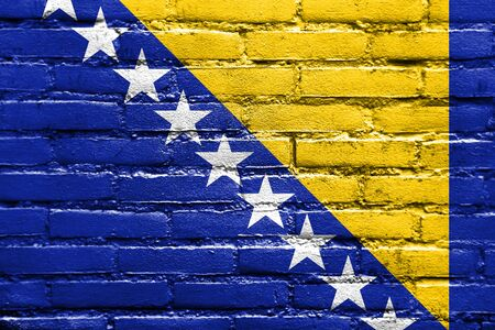 old flag: Flag of Bosnia and Herzegovina, painted on brick wall