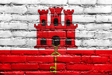 polity: Flag of Gibraltar, painted on brick wall