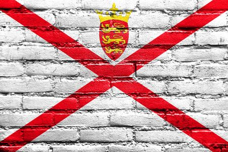 old flag: Flag of Jersey, painted on brick wall