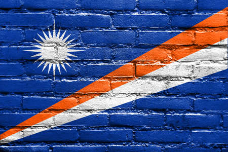 marshall: Flag of Marshall Islands, painted on brick wall Stock Photo