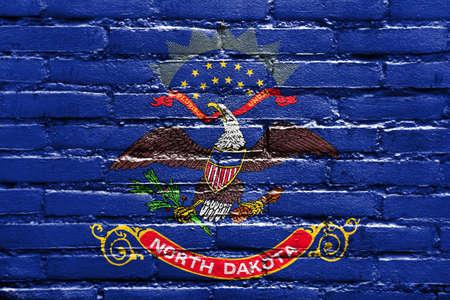 north dakota: Flag of North Dakota State, painted on brick wall Stock Photo