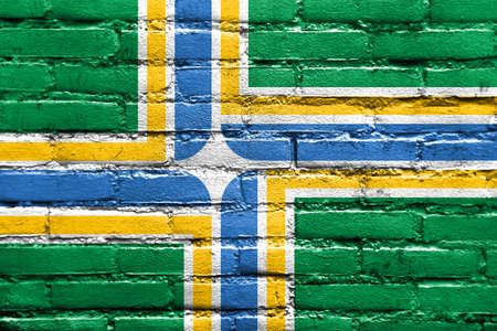 portland: Flag of Portland, Oregon, painted on brick wall Stock Photo
