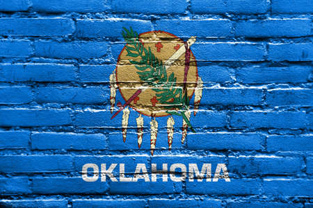 land mark: Flag of Oklahoma State, painted on brick wall