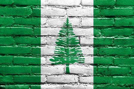polity: Flag of Norfolk Island, painted on brick wall