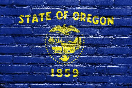 oregon: Flag of Oregon State, painted on brick wall Stock Photo