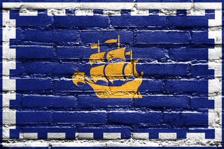 quebec city: Flag of Quebec City, painted on brick wall Stock Photo