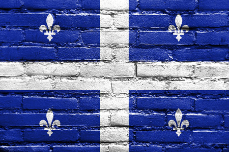 quebec: Flag of Quebec, painted on brick wall