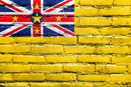niue: Flag of Niue, painted on brick wall Stock Photo