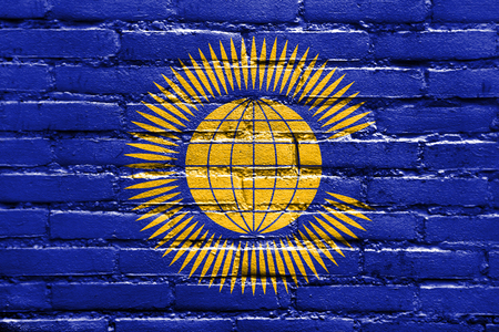nations: Flag of the Commonwealth of Nations, painted on brick wall