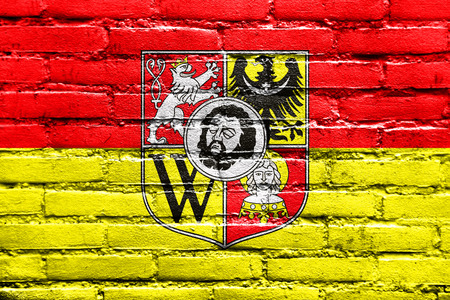 wroclaw: Flag of Wroclaw, Poland, with Coat of Arms, painted on brick wall