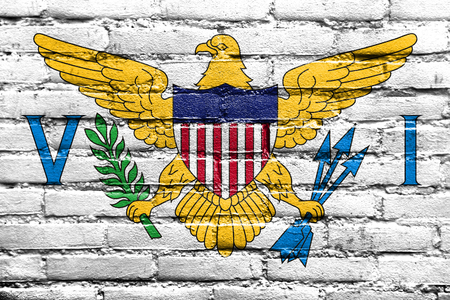 virgin islands: Flag of the U.S. Virgin Islands, painted on brick wall